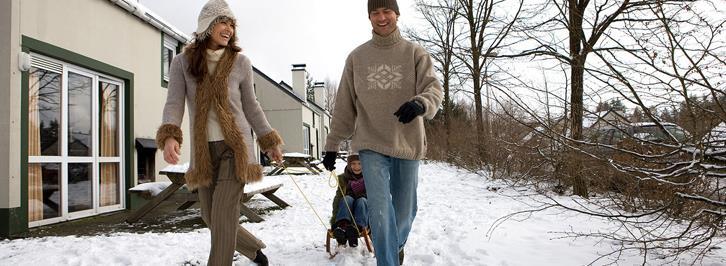 In de sneeuw bij de bungalow